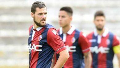 Mattia Destro e qualche giocatore del Bologna