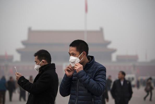 smog Pechino città quasi invisibile
