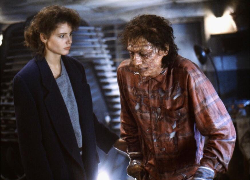 Geena Davis e Jeff Goldblum in una scena de La mosca